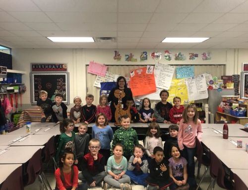 First Grade Class Adopts Hungry Dinosaur; Raises Funds for Community Projects